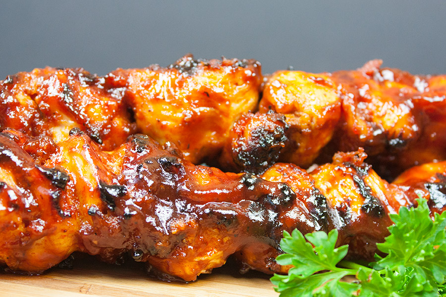 close up of Bacon Paste BBQ Chicken Kebabs with parsley garnish