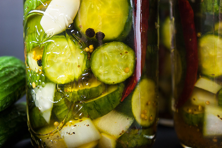 close up Spicy Bread and Butter Pickles in jars
