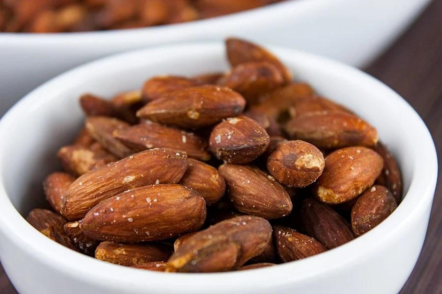 roasted salted almonds in a single serving white ramekin