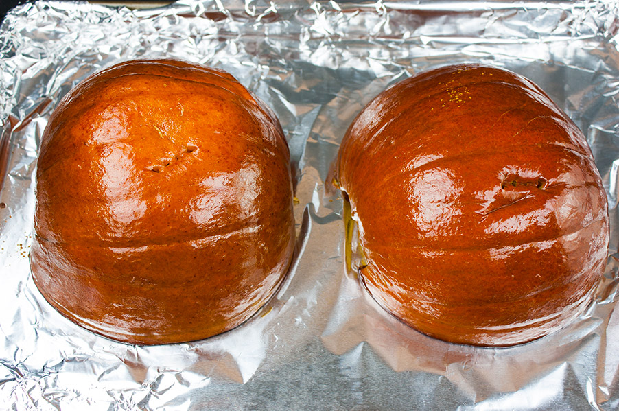 pie pumpkin roasted on a foil covered sheet pan