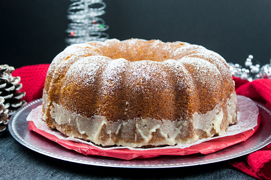 eggnog bundt cake on silver and red plates