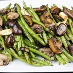 roasted green beans and mushrooms on a white serving platter