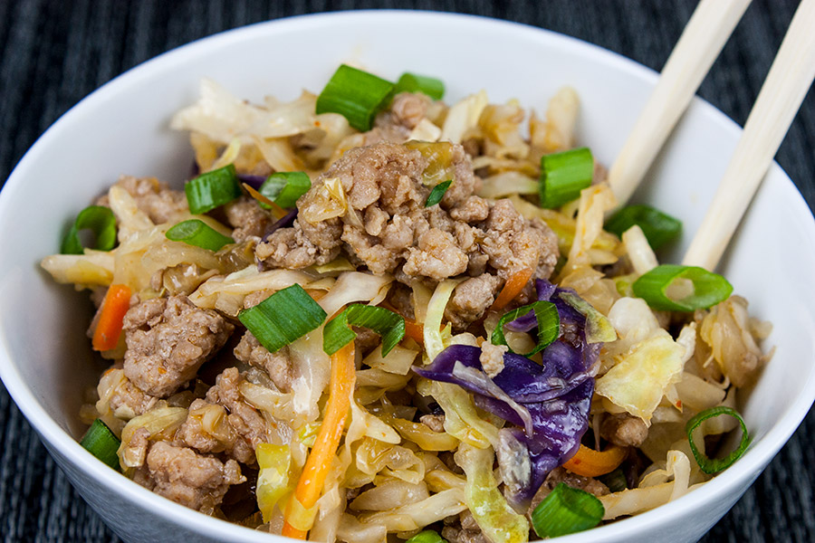 "Pork Egg Roll Bowl - Same great flavor as a traditional egg roll just without the wrapper. It's also known as ""crack slaw"". Super easy to make with budget-friendly ingredients."