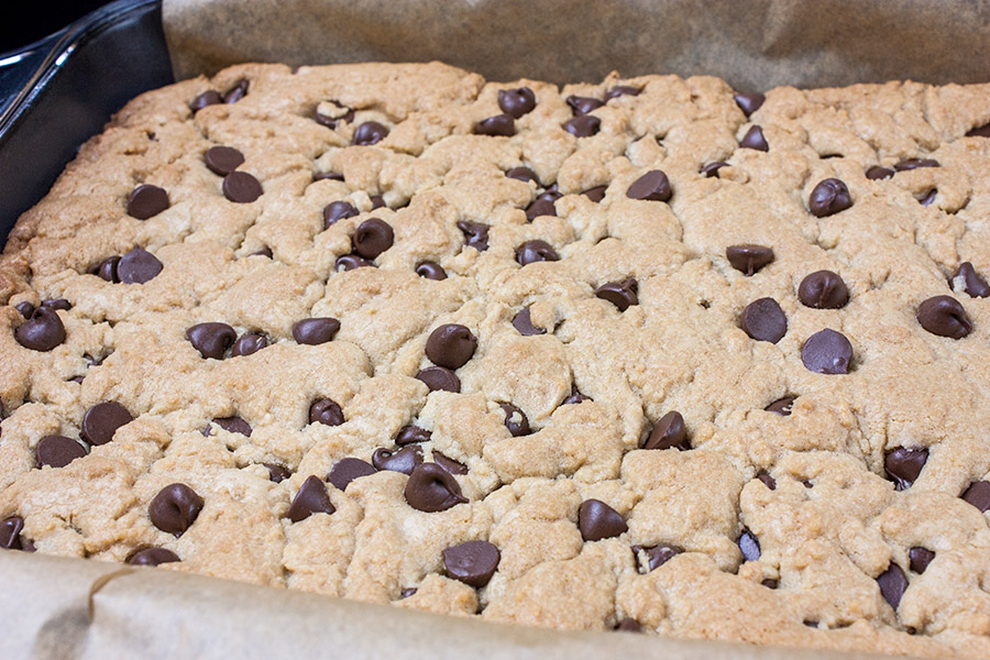 baked chocolate chip cookie bars in a 9x13 glass baking dish