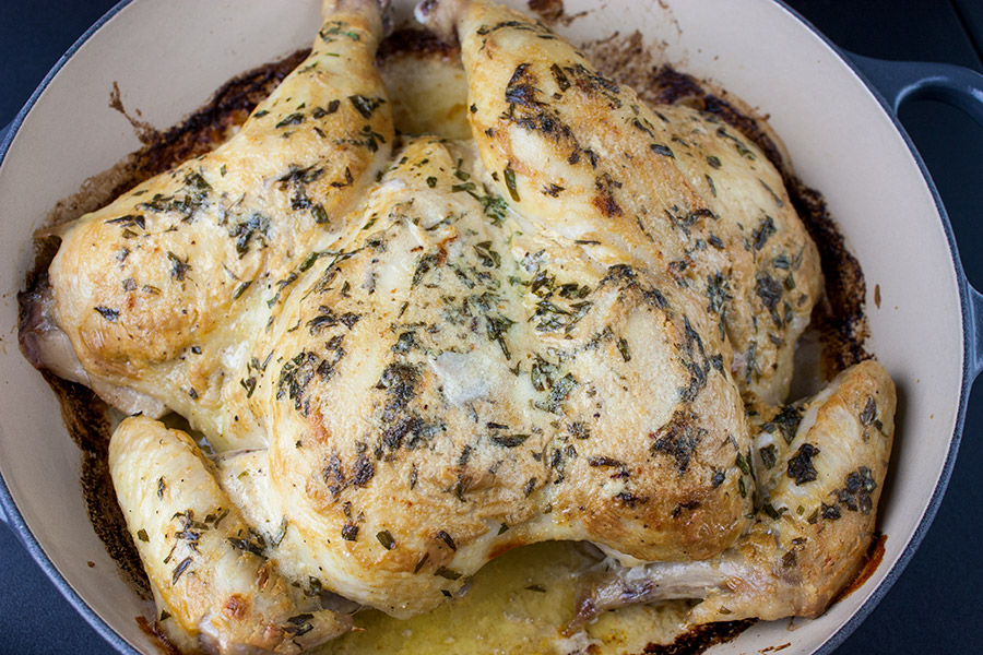 Roasted Chicken with Dijon Cream Sauce - Melt-in-your-mouth delicious! My take on the French Poulet à la Dijonnaise. Tender roasted chicken smothered in a creamy, tangy, tarragon sauce.