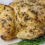Roasted Chicken with a Dijon Cream Sauce - Melt-in-your-mouth delicious! My take on the French Poulet à la Dijonnaise. Tender roasted chicken smothered in a creamy, tangy, tarragon sauce.