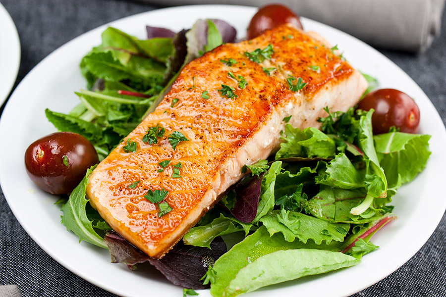 Pan-Seared Salmon Salad with Lemon Dijon Vinaigrette - One of the quickest, healthiest meals you can serve your family! Fresh homemade vinaigrette brings tons of tangy, zesty flavor.