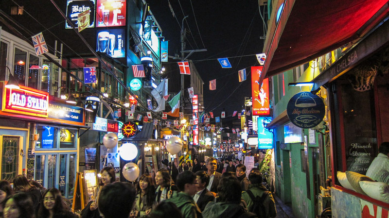walking down an alley in itaewon at night