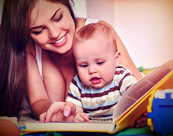 Mother Reading to Her Baby small