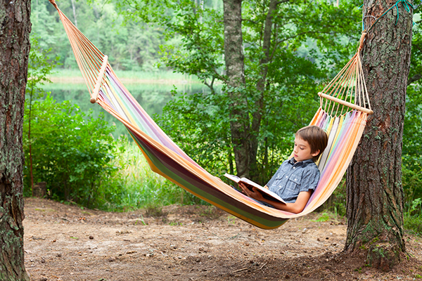 Boy Reading Book Outside small