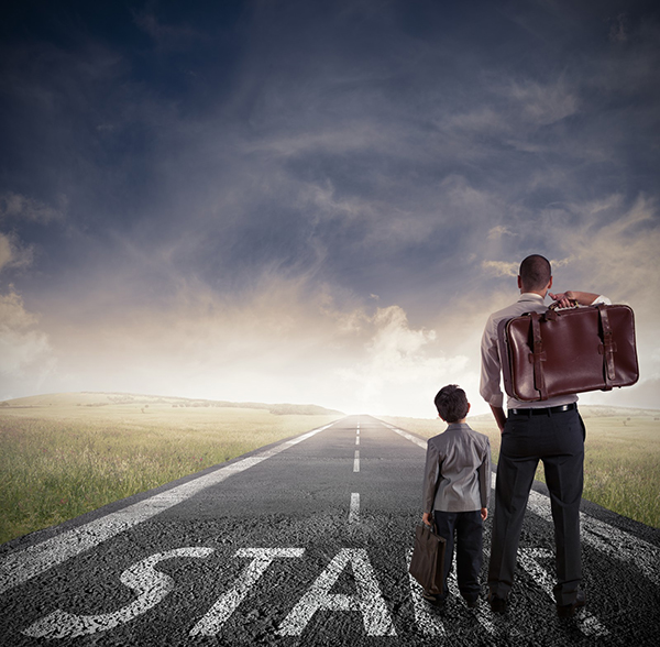 """A father and son carrying luggage head down a long road toward the horizon. At their feet is the word """"start."""" Working with dyslexia is a long road, and it takes true perseverance to keep going."""