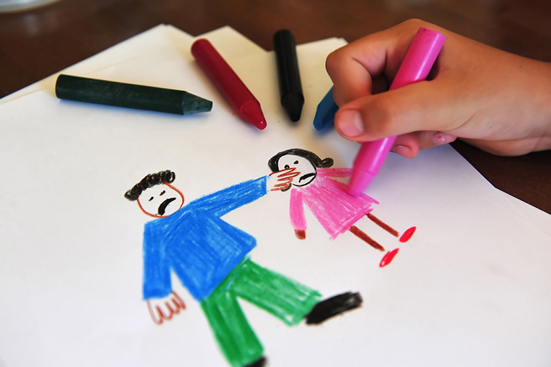 A child's drawing shows an angry father pointing at an angry little girl. Drawing is a way of helping dyslexic children illustrate their feelings when they are stressed, especially about the uncertainty of new circumstances and learning at home.
