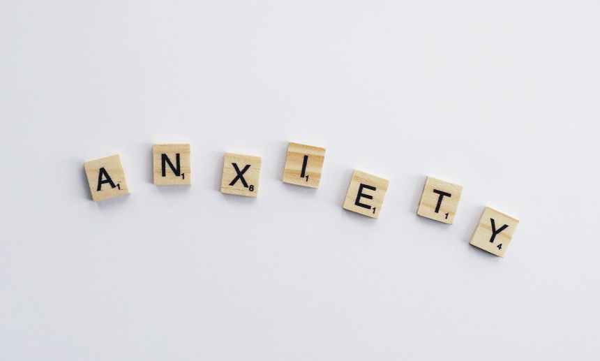 white and brown wooden game tiles with letters on them spell out the word anxiety. Conquering worry and anxiety is an ongoing process, but here are some tips that can help.