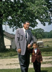 Author Don M. Winn with his father as a child in Colorado, outside in the garden, dressed in their nice suits.