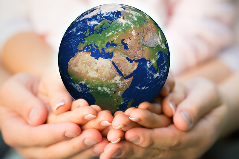 A photo of a father's, mother's, and child's hands holding the earth. Learning about dyslexia as a family means gaining a better understanding of dyslexia and being better able to address the challenges of dyslexia. The multiple deficit model of dyslexia means looking for potential multiple contributing factors to dyslexia.