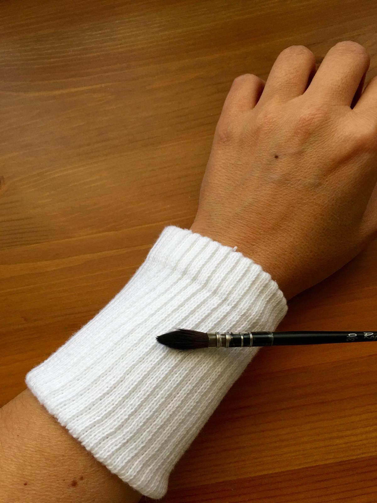 Tube sock around wrist to act as a watercolor brush wipe and watercolour brush