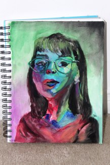 Doodlewash by Sam Orpiada watercolor sketch of woman in glasses portrait in red and green