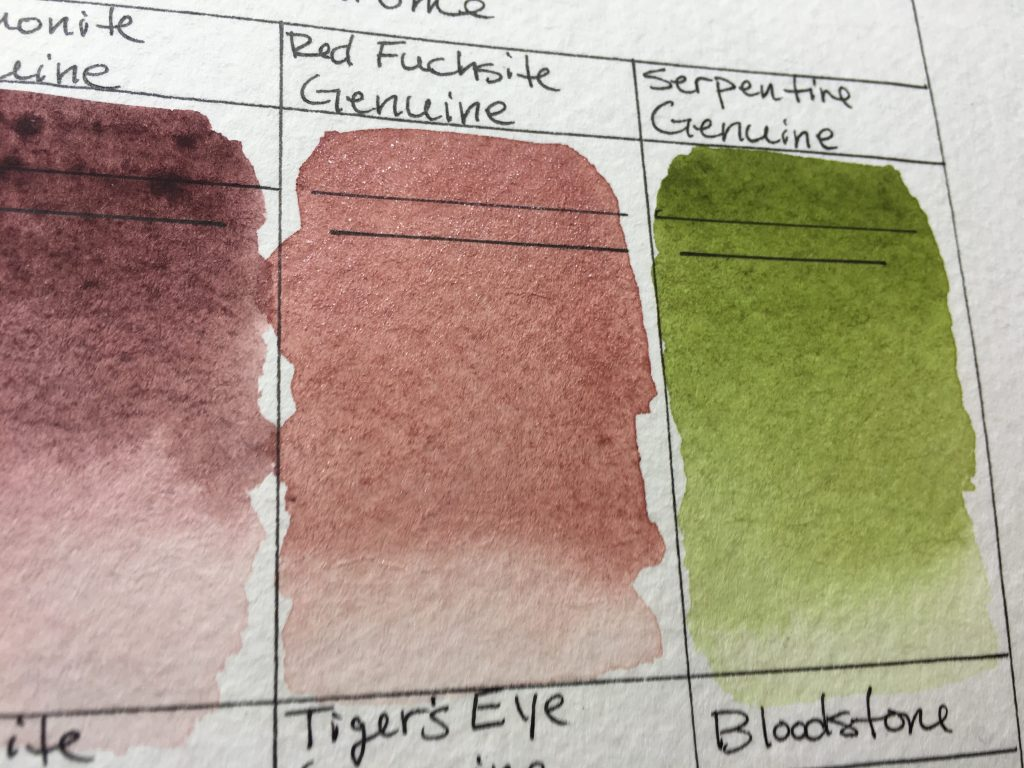 Daniel Smith PrimaTek watercolors swatches on Strathmore 400 series watercolor paper Red Fuchsite Genuine and Serpentine Genuine