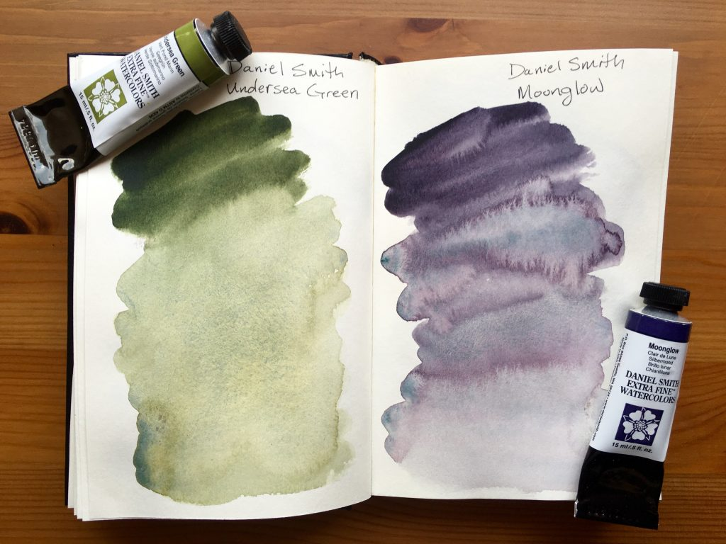 Daniel Smith Extra Fine watercolors paint swatches of Moonglow and Undersea Green in a stillman and birn gama series journal