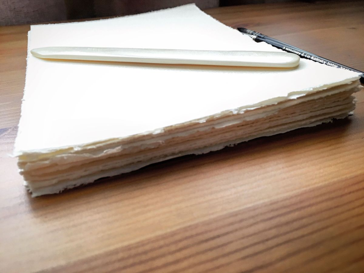 fabriano torn watercolor paper and bone folder