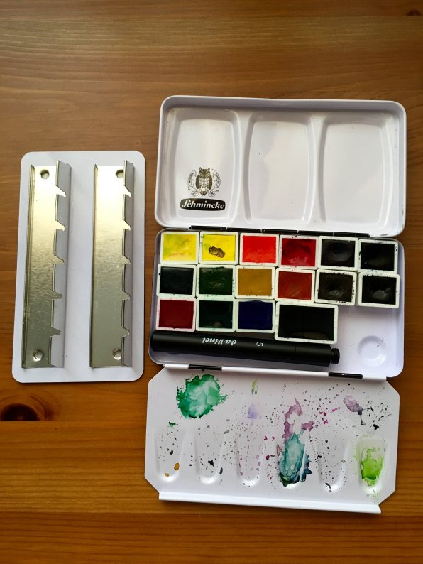 Schmincke metal watercolor travel palette with a da vinci size 5 travel brush with tray removed