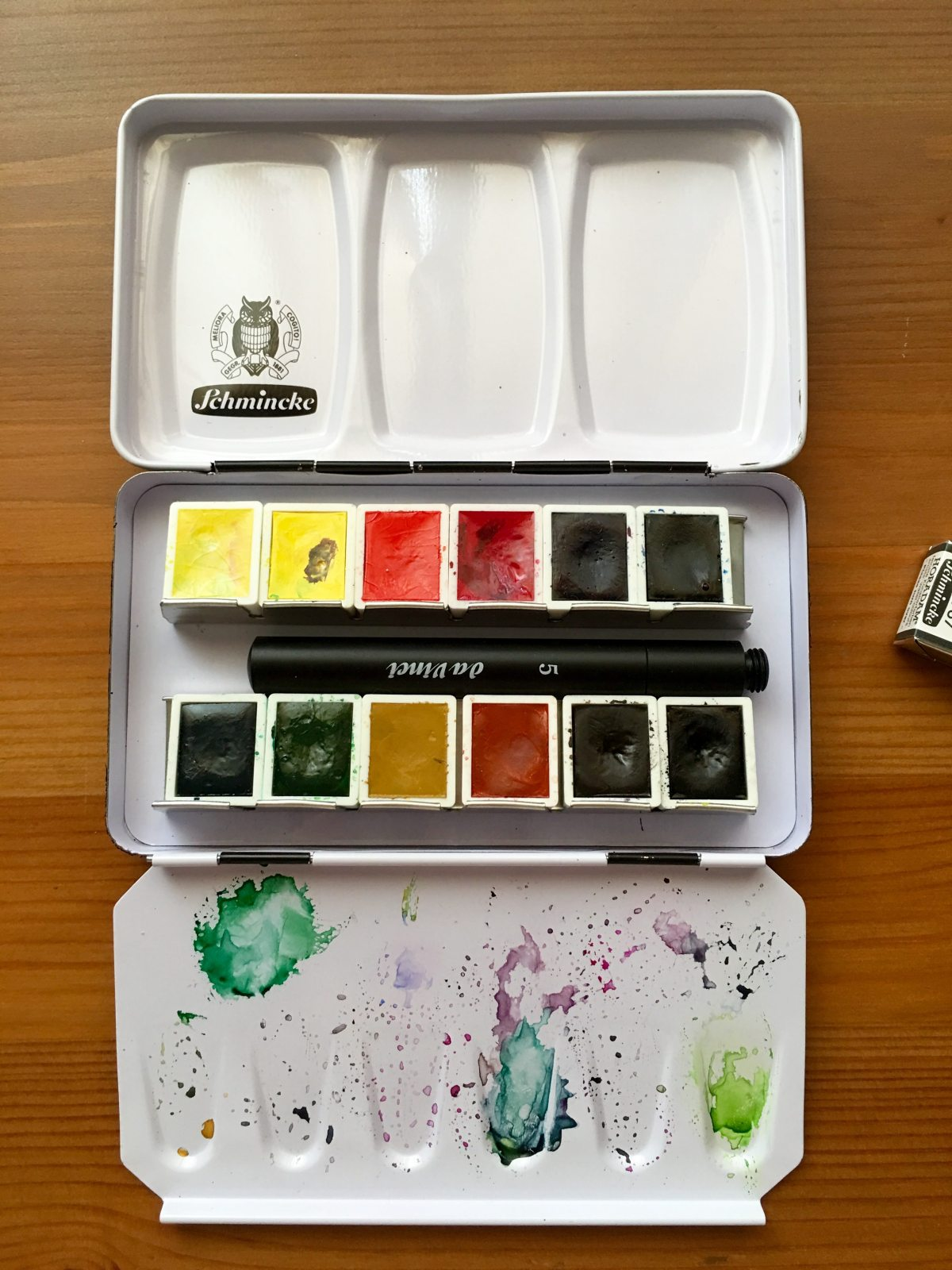 Schmincke metal watercolor travel palette with a da vinci size 5 travel brush