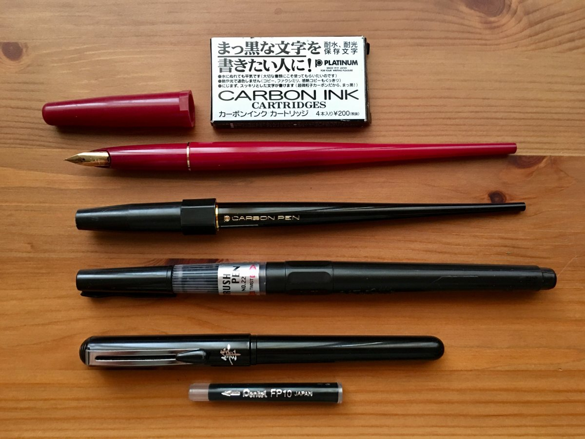 platinum carbon desk fountain pen, pilot desk pen, zig cartoonist brush pen No. 22, pentel brush pen, waterproof ink, platinum carbon ink