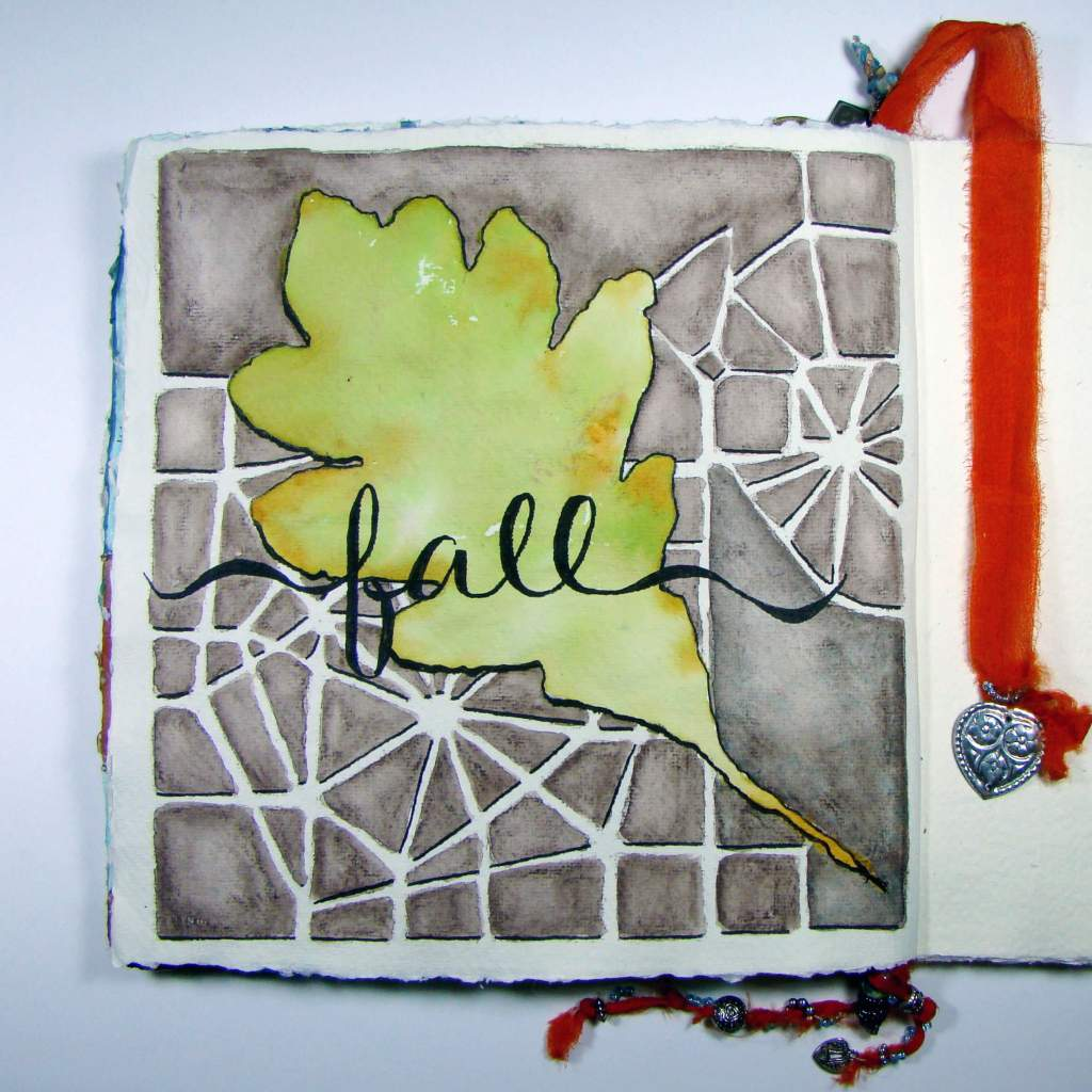 Leaf painted with ColourArte in Khadi journal Fall by Sandee Setliff