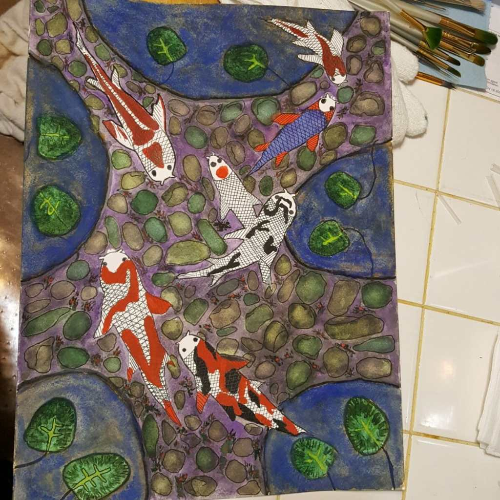 I tried to improve on my other Koi painting by using better paper and paint and making the fish diff