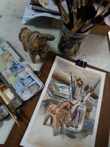 "A watercolor of a mess on my desk, with a little ""Torito de Pucará"" (little bull of Puc"