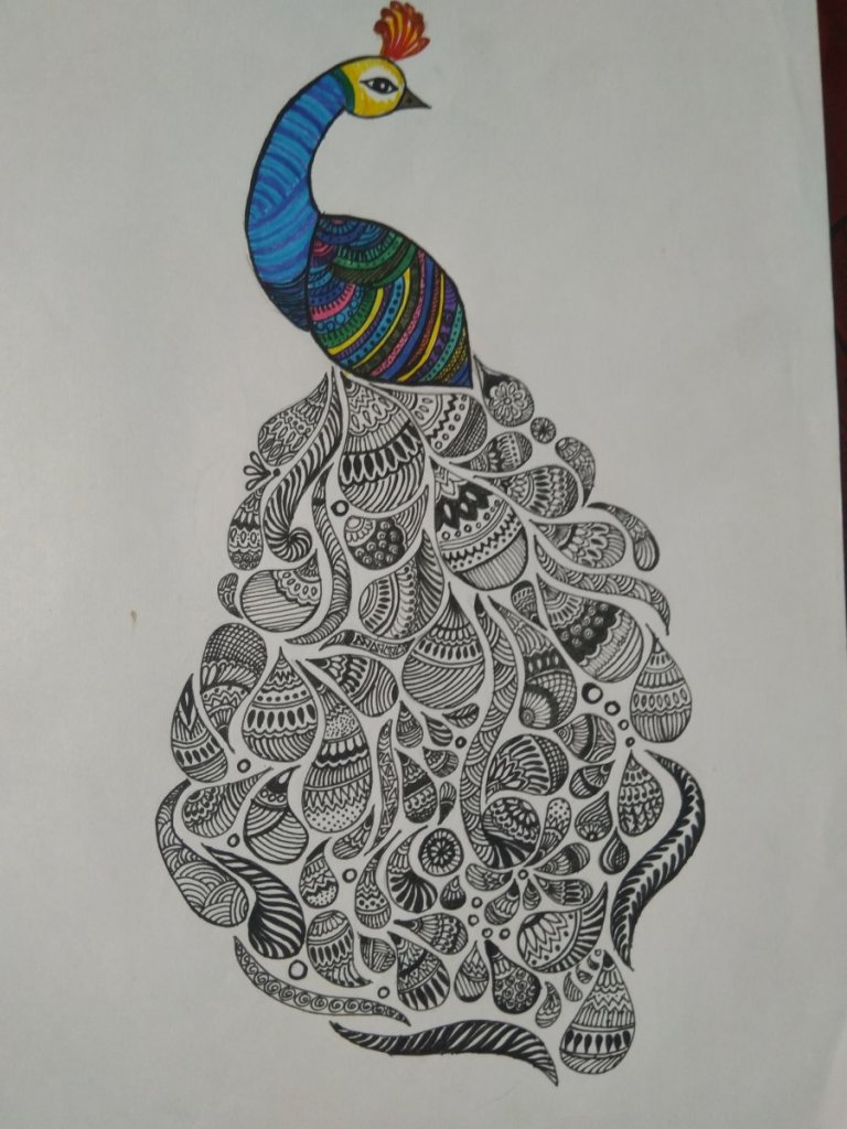 Peacock with designer feathers! It's a pen art. IMG_20181127_114617