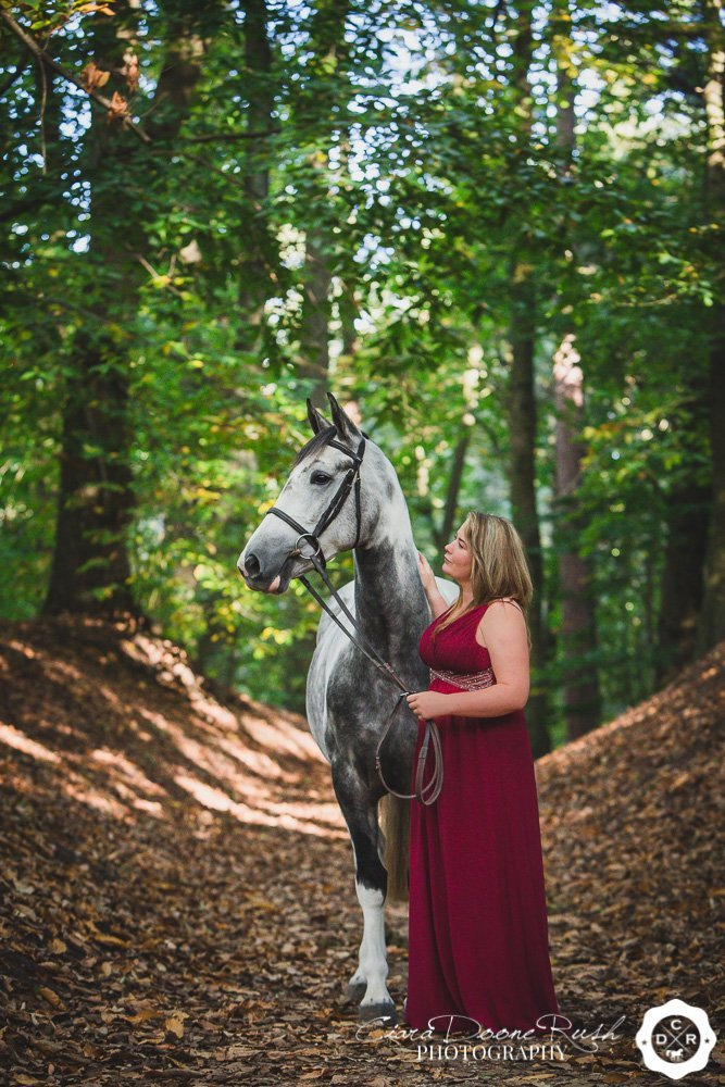 girl in a dress with her horse