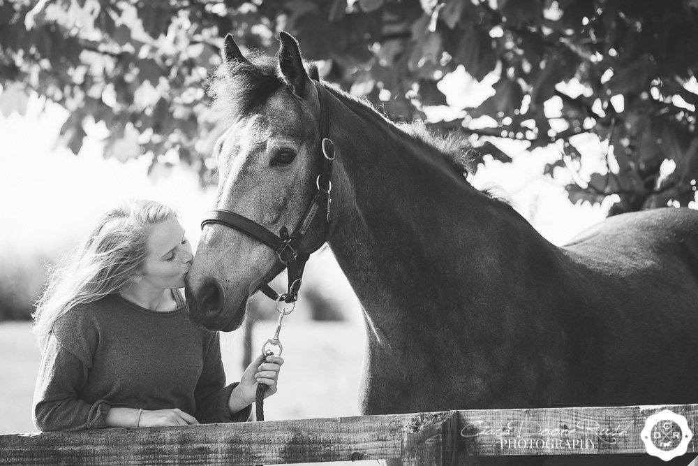girl kissing pony