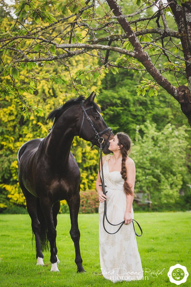 a girl in a ball gown with her horse