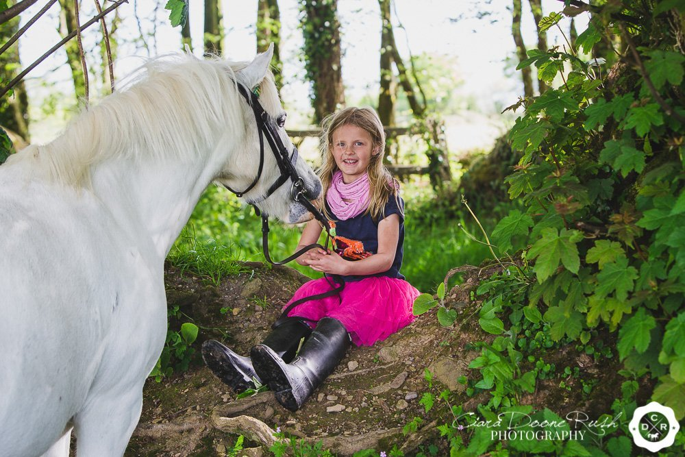 little girl and her pony on a photo shoot