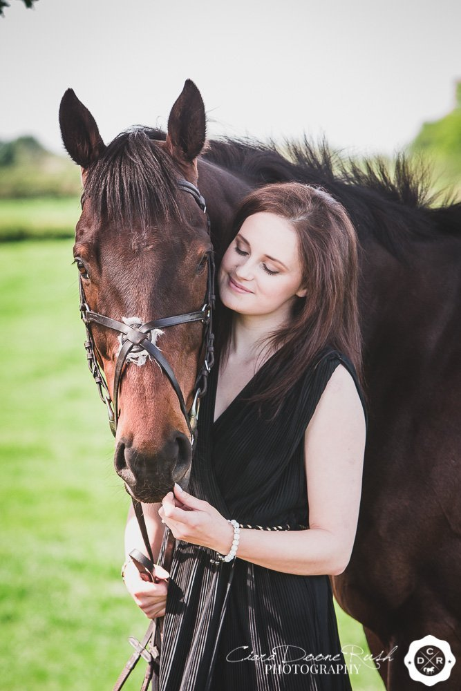 A girl in an evening dress and her horse