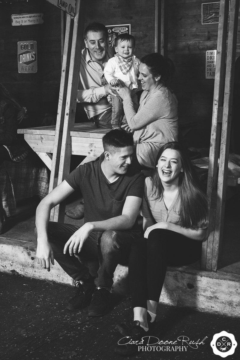 a family photo shoot in the rain