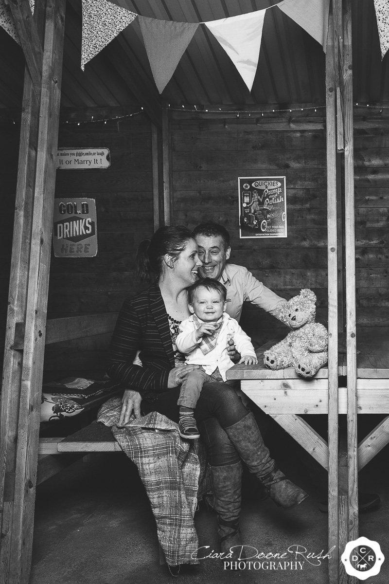 a family photo shoot in a barn