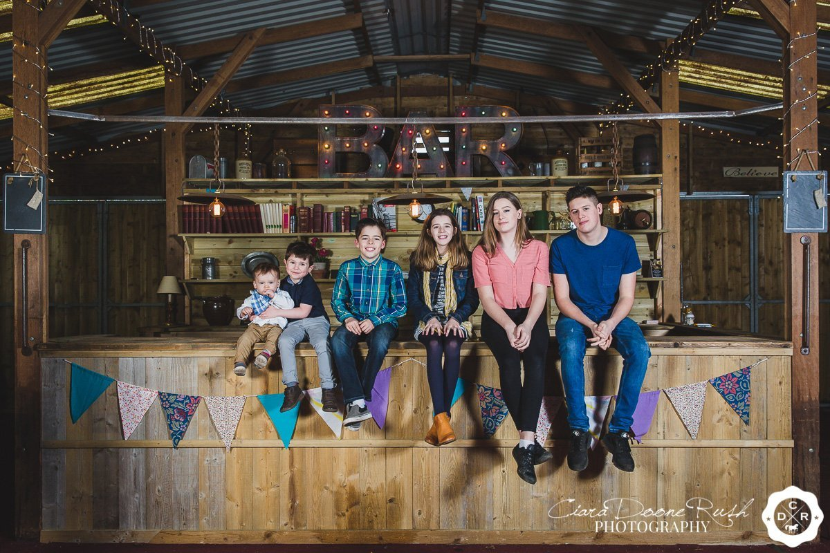 a family photo shoot in a barn in cheshire