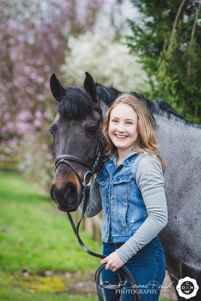 a girl and her pony on a photo shoot