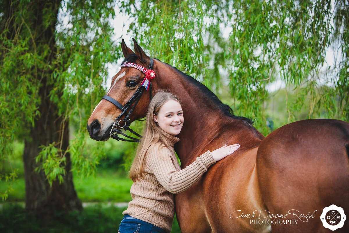 a girl and her show pony on a photo shoot