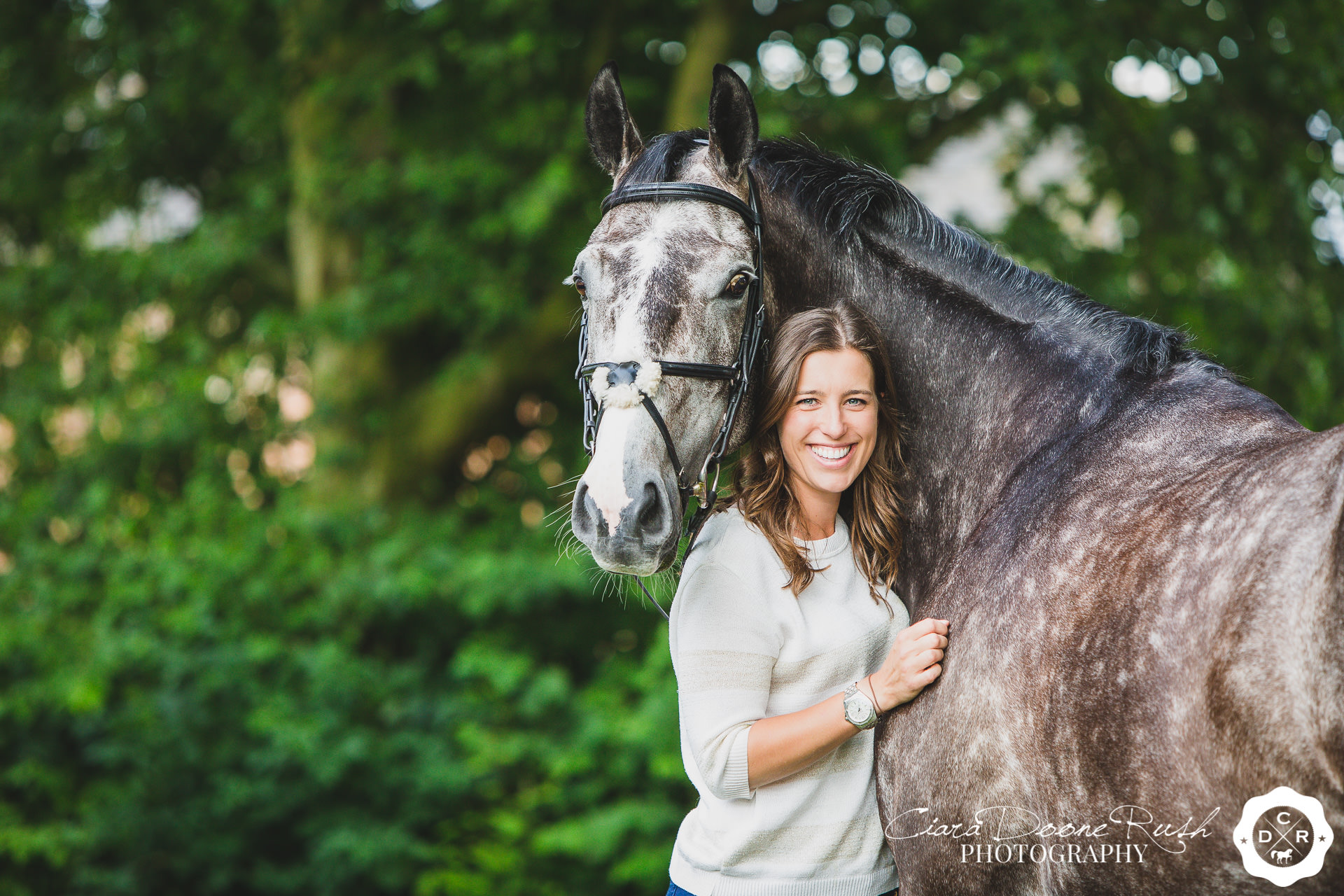 A woman and her irish sports horse on a horse and rider photo shoot