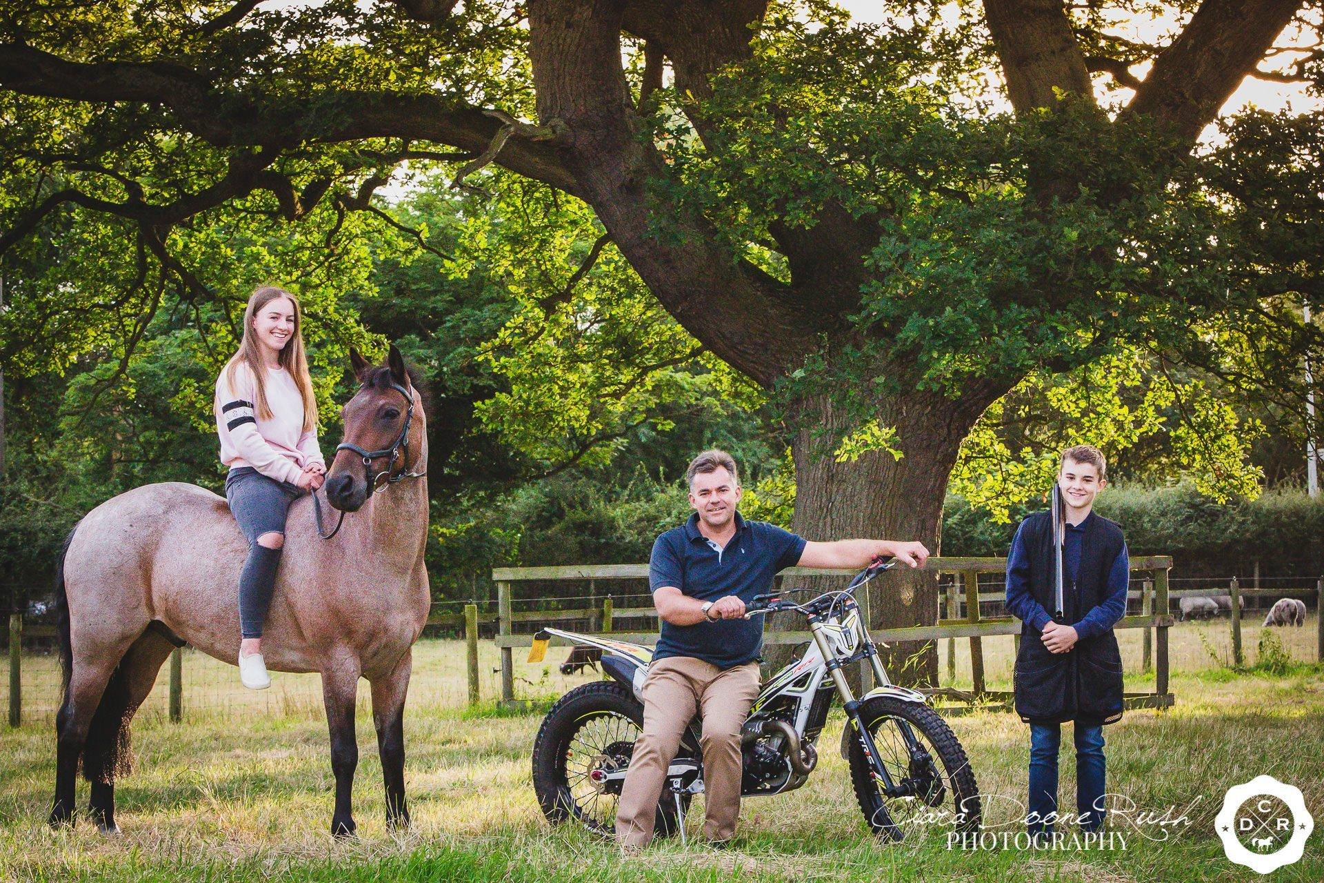 A family with their horse and motorbike on a family and animals photo shoot