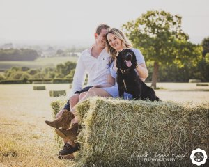 a couple and their dog on a photo shoot
