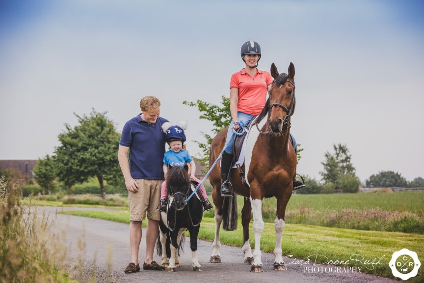 a family and their animals on a photo shoot