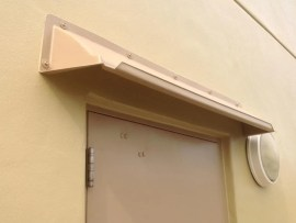 Affordable entrance door canopy or hood mounts above door to stop leaks. Front gutter prevents dripping.