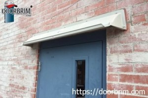 Affordable entrance door awning, canopy or hood mounts above door to stop leaks. Front gutter prevents dripping.