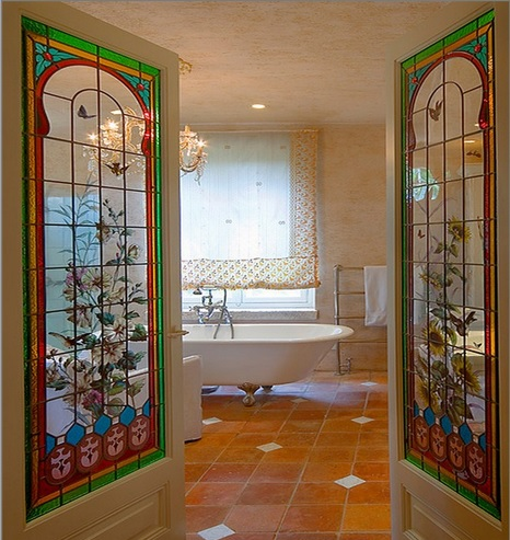 Bathroom with interior stained glass French doors