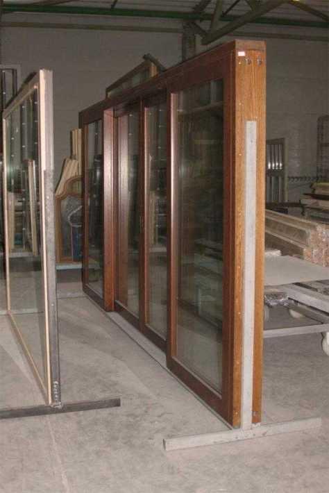 Сдвижная оконная система евроокна деревянные со стеклопакетами на производстве