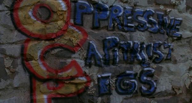 OCP Oppressive Capitalist Pigs, graffiti da Robocop 3